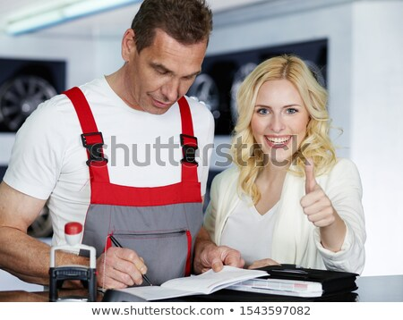 woman in overalls with tires, car service Stock photo © studiostoks