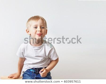 Funny caucasian boy teasing with hands. Stock photo © RAStudio
