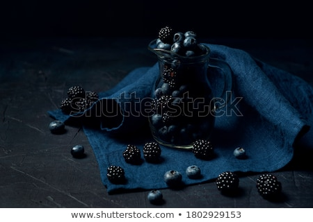 Blueberry scattering from glass jug  Stock photo © dash