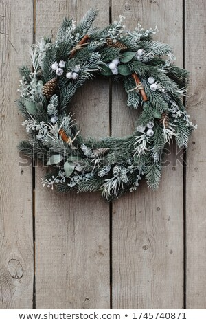 christmas wreath on white wooden background stock photo © dash