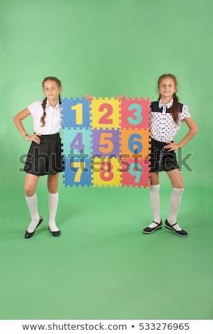 A girl holding number four Stock photo © bluering