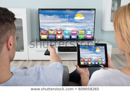 Woman Connecting Television Channel Through Digital Tablet Stock photo © AndreyPopov