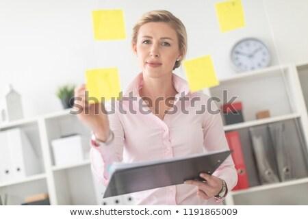 Fiatal szőke nő lány iroda átlátszó tábla Stock fotó © Traimak