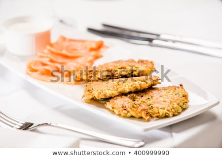 Zucchini fritters with salmon Stock photo © YuliyaGontar