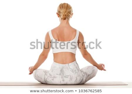 Vonzó fiatal szőke nő testmozgás ül jóga Stock fotó © dash