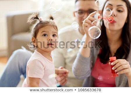 Père bébé fille bulles de savon maison famille Photo stock © dolgachov