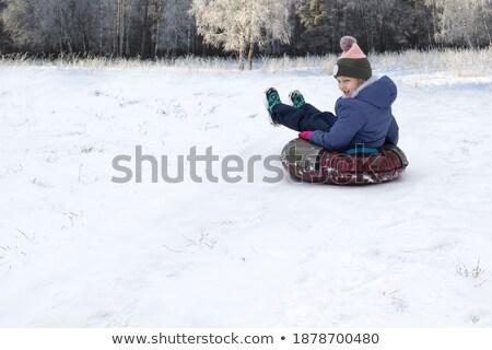 Family Tubing and Children Sitting on Sledges Stock photo © robuart