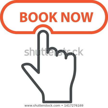 Parmak düğme kitap şimdi rezervasyon Stok fotoğraf © Winner
