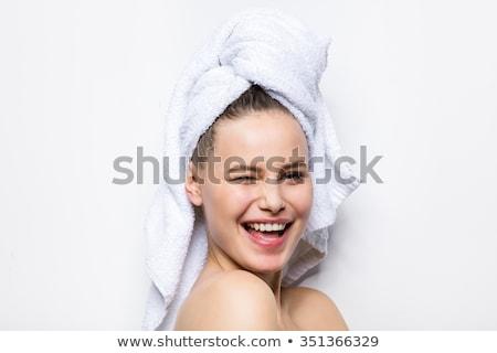 mujer · sonriente · mirando · vidrio · bano · mujer · modelo - foto stock © nyul