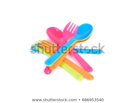 Served place with disposable plastic utensils on pink. Stock photo © artjazz