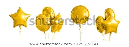 Muchos metálico oro helio globos blanco Foto stock © dolgachov