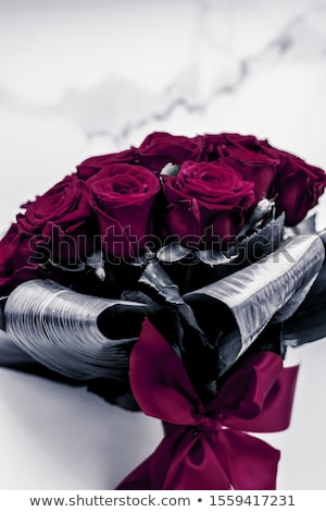 Luxury bouquet of maroon roses on marble background, beautiful f Stock photo © Anneleven