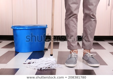 Man Mopping The Floor In Kitchen Stock photo © AndreyPopov
