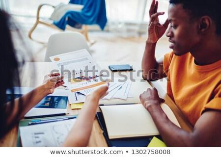 Explaining printing process to colleague Stock photo © pressmaster