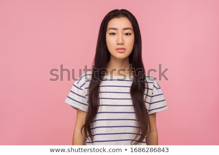 Portrait of serious brunette female with healthy skin, looks confidently at camera, has dark straigh Stock photo © vkstudio