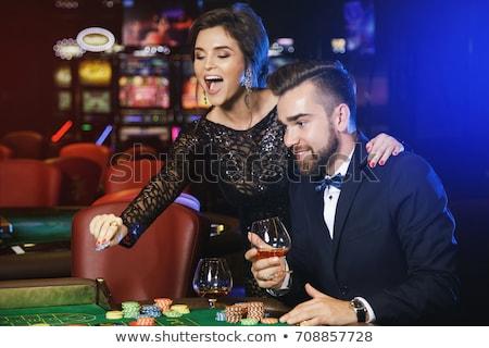 Güzel kız konyak cam siyah elbise kadın gülümseme Stok fotoğraf © pekour
