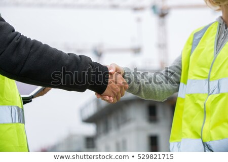 Stock photo: A female construction worker about to shake hands.