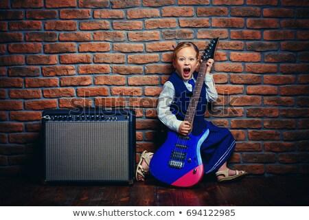 ロックスター エレキギター 笑みを浮かべて 孤立した 白 岩 ストックフォト © feedough