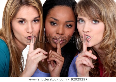 Three women with the fingers to their lips Stock photo © photography33