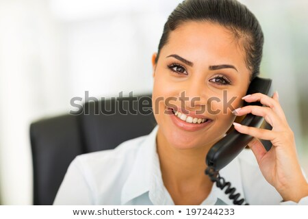 Businesswoman using a landline Stock photo © photography33
