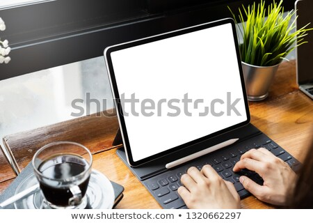 business professionals looking at a notebook stock photo © photography33