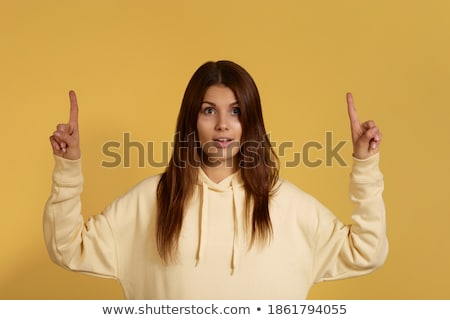 mujer · senalando · ambos · manos · atractivo · sonriendo - foto stock © stockyimages