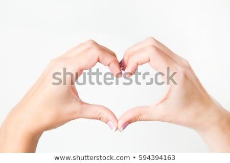 kobieta · wskazując · palec · serca · piękna · kobieta · bawełny - zdjęcia stock © dolgachov