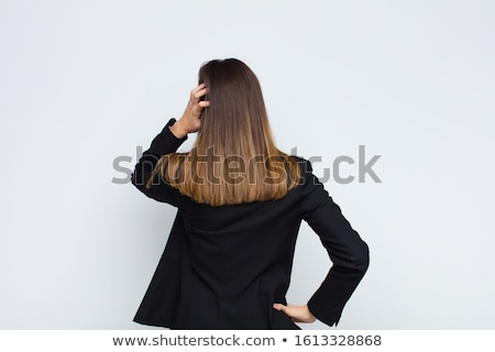 Young businesswoman clueless against a white background Stock photo © wavebreak_media