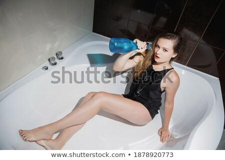 Alluring blonde lady in nice pose Stock photo © konradbak