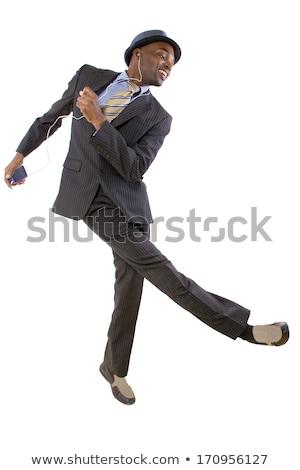 Handsome businessman dancing hearing music stock photo © lunamarina