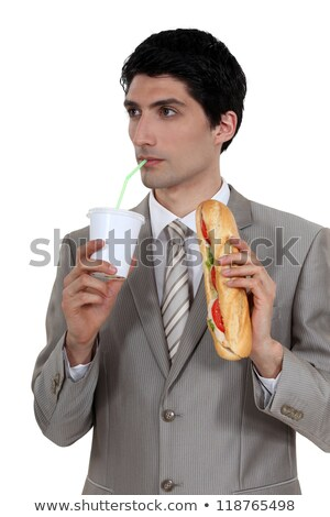 smart pensive businessman having quick lunch break stock photo © photography33