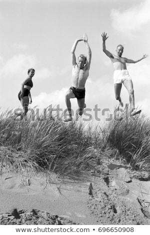 Uomo vintage costume da bagno piedi spiaggia viaggio Foto d'archivio © Kirill_M