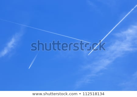 Deep blue sky with many  contrails  Stock photo © meinzahn