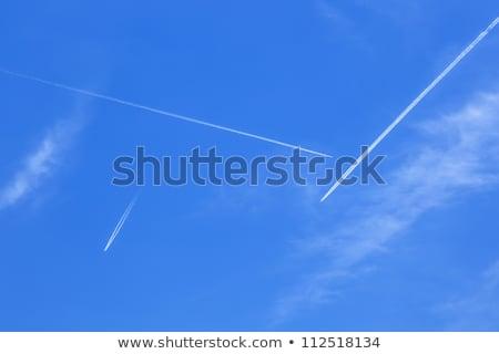 branco · condensação · trilha · jato · azul · blue · sky - foto stock © meinzahn