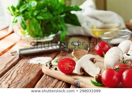Cherry tomatoes with mushrooms and garlic on cutting board Stock photo © karandaev