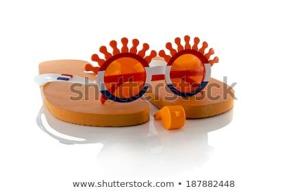 plastic glasses horn flute slippers  and flag in orange Stock photo © compuinfoto