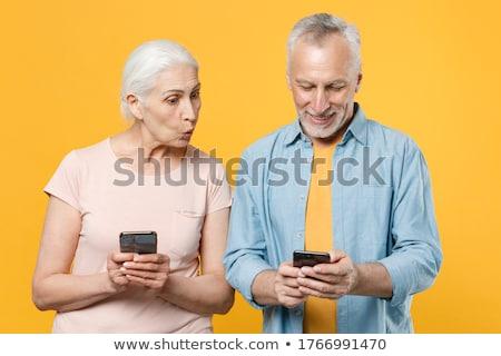 elegant couple reading a text message on mobile stock photo © dash