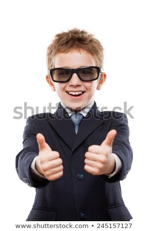 smiling child boy in business suit wearing sunglasses gesturing stock photo © ia_64