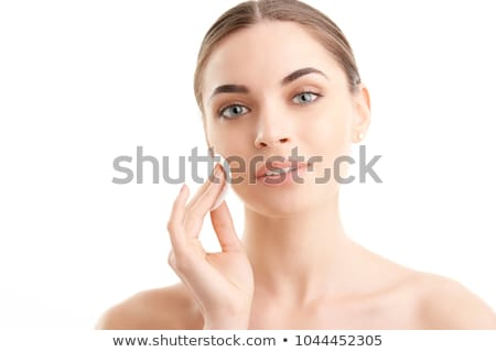 Woman Washing her Face While Looking at the Camera Stock photo © juniart