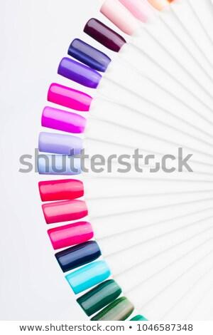 Vrouw hand keuze nagellak geïsoleerd witte Stockfoto © tetkoren
