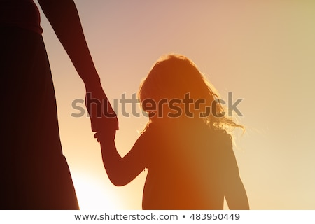 mother holds children for the hands on the sunset stock photo © Paha_L