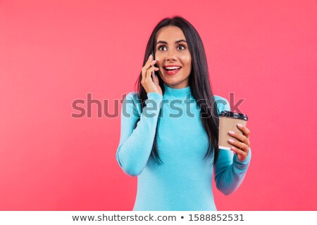 Happy beautiful young woman laughing and talking on cellphone Stock photo © deandrobot