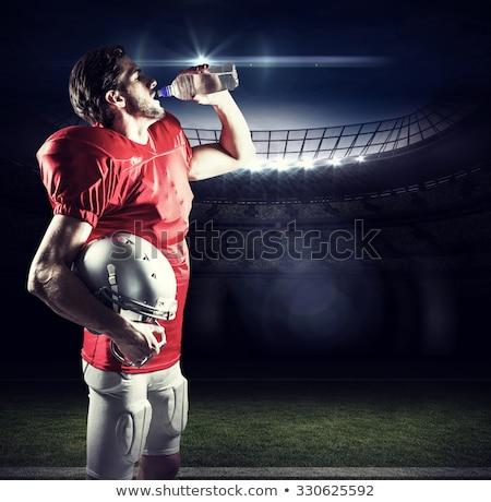 Amerikaanse voetballer drinken zwarte sport fles Stockfoto © wavebreak_media