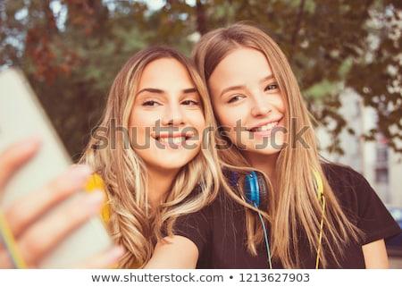 Two teenage girls friend with sunshine in hair Stock photo © zurijeta