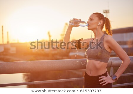 Drinking water after running outdoors Stock photo © blasbike