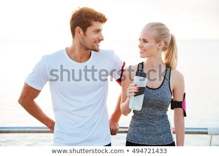 nő · férfi · biciklisták · okostelefon · együtt · pihen - stock fotó © deandrobot