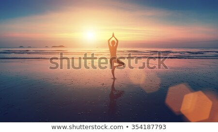 silueta · yoga · mar · playa - foto stock © orla