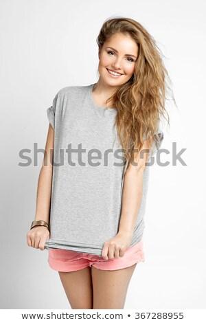 young beautiful blond female posing Stock photo © konradbak