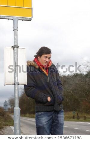 Férfi kezek áll vidéki út külső felfelé Stock fotó © feedough