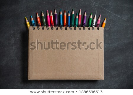 Color pencils lying on paper on brown wooden desk Stock photo © Sonya_illustrations